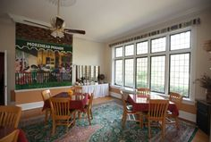 This is the sunny Pecan Dining Area at Morehead Manor Bed and Breakfast in #Durham, NC. The Owners/Innkeepers Monica & Daniel had an artist replicate the style of a picture by hand-painting this mural on their wall.  If you look closely, you will see Morehead Manor on the awning.