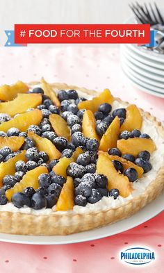 Red, white, and blueberry! This Blueberry and Peach Cream Tart, featuring PHILADELPHIA Cream Cheese, fresh peaches and blueberries, and COOL WHIP will own the dessert table at your 4th of July parties.