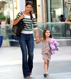 Katie Holmes and Suri  The Kennedys star's 6-year-old fashionista shopped at a Toys R Us store in Hollywood.
