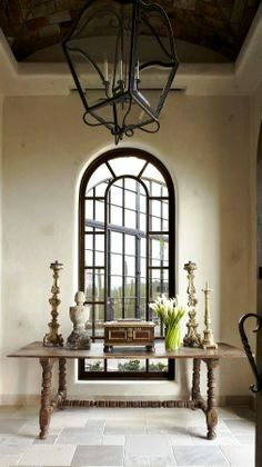 Lovely window, lantern and table composition.  Note the brick arched ceiling in the cove.