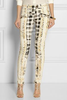 Channel Balmain's edgy glamour with these stretch-denim moto-style jeans. Featuring a gold chain print over black and white checks, this skinny pair can easily transition from day to night with a silk blouse and sandals.