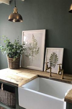 Green and brass look incredible when paired! Olive Green Kitchen, Green Kitchen Walls, Green Kitchen Decor, Olive Green Walls, Küchen Design, House Design, Utility Room Designs, Estilo Interior, Laundry Room Design