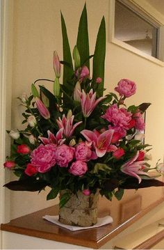 Pink lilies, cream roses, pink peonies #large flower arrangements#churchflowers