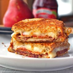This grilled cheese sandwich is stuffed with bacon, pear slices, and raspberry preserves for a salty-sweet combo that is simple to make and so addicting.