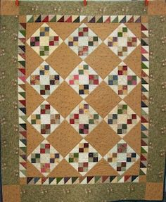 Amy's Four Patch by Jo Morton.  Gosh this reminds me of a quilt I have upstairs.  Love it!