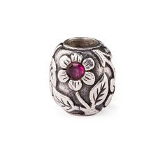 This bead  has four red crystals in the center of the four flowers…