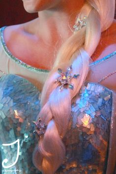 Costume Detail: Elsa's Hair Snowflakes. I actually couldn't stop staring at these during the movie.