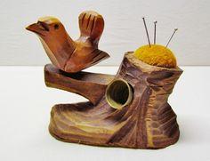 Vintage pincushion - primitive carved wood bird pincushion/thimble holder. $35.00, via Etsy.
