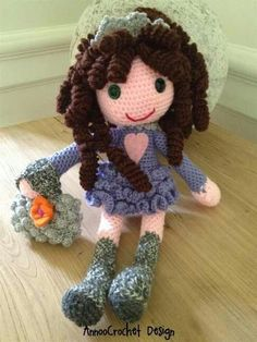 Crocheted doll with purse