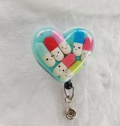 Happy pills pharmacy, pharmacy tech, nurse name badge holder with blue background and happy pills detail Pharmacy Gifts, Pharmacy Humor, Pharmacy Technician, Nurse Name Badge, Biscuit, Nursing Accessories, Happy Pills, Name Badges, Polymer Clay Miniatures