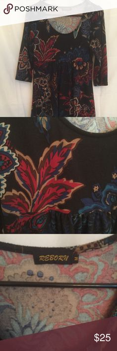 Reborn Medium Black Floral A-line tunic dress Never worn, tag removed. Never washed/dried. Stretchy heavy weight material. Perfect for fall/winter. Elbow length sleeves, Baby doll style floral patterned tunic (or short dress). It's a black background with cranberry, beige, cobalt blue, and brown paisley highlights. Reborn Tops Tunics