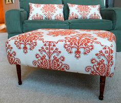 love the idea of making an ottoman and matching throw pillows for the couch.