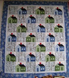 """""""Winter Houses"""" ~ love the trees with birds in between the houses. Wonder if it's a print or embroidered? Great quilt!"""