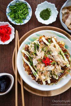 "Okonomiyaki...a Japanese savory pancake with various toppings sometimes called ""Japanese pizza""."