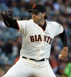 San Francisco Giants pitcher Barry Zito throws to the Atlanta Braves during the first inning of a baseball game in San Francisco, Thursday, Aug. 23, 2012