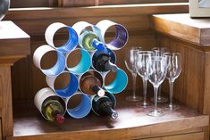 Make a wine rack out of empty coffee cans.