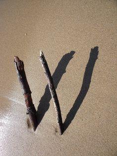 Ecrire avec 2 bouts de bois...et faire un W.