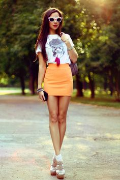 cute retro look with a bright orange skirt and floral shades!