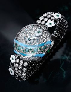 Fabergé watches Summer in Provence high jewellery timepiece features a garland of white mother-of-pearl flowers, meandering across the diamond and gem-set dial and bracelet. Limited to five pieces, the 37mm model comes in a white gold case, set with 322 d