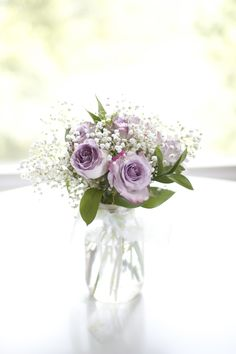Centerpiece: purple roses in mason jars with greenery & babys breath