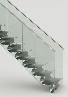 Staircase revolution: Black carbon stairs by EeStairs (Dutch, 2011) • rethink: straight, helical, spiraled, folding, single-flight, multi-flight, with or without a plinth, with or without stringers & handrails, in wood / steel / glass, cantilevered or wall steps...for peep's sake let's think not normal/status quo/standards...let's Think Different. Rethink colors / materials / structural design...