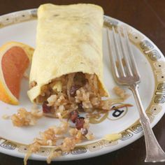 Fried-Rice Omelette  In this dish, a popular order at Teshima's, a restaurant in the Big Island town of Kealakekua, a thin omelette is folded around a filling of fried rice and sausage.