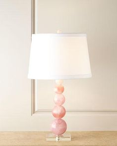 Lighting - Handcrafted lamp base made of clear and natural pink quartz with a linen shade.