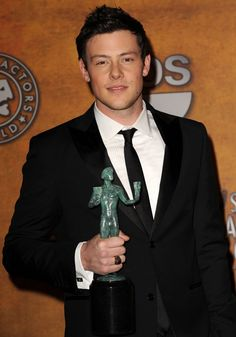 Pin for Later: Remembering Cory Monteith's Life in Pictures  Cory Monteith posed with his award at the 2010 SAG Awards.