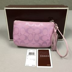 Coach Soft Large Signature Wristlet Still with its box, tag, and manufacturer's booklet, this barely-used Coach signature wristlet in pretty pink with silver hardware is perfect for carrying your essentials when on the go, or simply use to hold everyday items and switch between handbags in an instant!  Large enough to hold an iPhone, card case, keyfob/keys, purse mirror, my blotting papers, and couple of lipsticks and lipglosses!  The suede tassel adds fun character while the leather strap…
