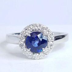 18K White Gold Blue Sapphire: Round Cut 1.07ct  Diamonds: 0.34ctw Quality: F-G color, VS-SI clarity
