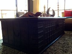 Beautiful way to add storage, cultural style, and originality to a small home or condo! This chest is a hand made piece from India! I added the turtle, Bahraini tea set, and modern table top fire place for added style!