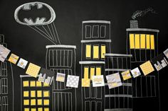 Kids Birthday Party Ideas: Searching for Superheroes! Cityscape mural was used as the backdrop for the food table and a photo booth! #superhero #birthday