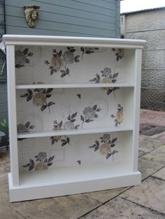 A gorgeous book/display cabinet hand painted in F&B Clunch with a french wallpaper backing only from Heatherspatch<3