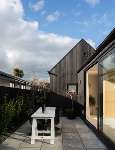 Architectural designer, Tobin Smith discusses his modern cottage in inner-city Christchurch and how storage and sunlight are invaluable in a small home Urban Cottage, Modern Cottage, Barn Style House Plans, House Cladding, Black House Exterior, Urban Barn, Simple Aesthetic, Inside Home, Small House Design