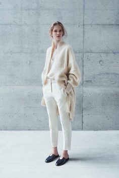 Soft, warm, understated yet noticeable. These are words that describe the coveted minimalist aesthetic. This oversized knit cardigan goes perfectly with a silk blouse, tailored cream colored trousers, and flat mules. Can we all agree that this look is beyond perfect?