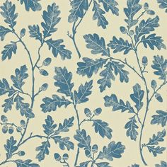Oakwood Wallpaper A beautiful wallpaper with a design of oak leaves printed in indigo on a beige ground. The design originated as a lino print created by carving the pattern onto lino which was then inked with a roller and impressed onto paper.