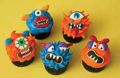 Amy, this could give you an idea of what to buy for Elam's b-day. We can dip M&Ms in white chocolate for eyes like those.