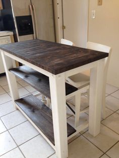 2 half shelves, End Grain Kitchen Island butcher block top with seating for 3 or 4 - Rustic wood farmhouse style kitchen table Small Kitchen Tables, Kitchen Island Table, Farmhouse Kitchen Island, Kitchen Island With Seating, Farmhouse Table, Rustic Kitchen, Kitchen Shelves, Kitchen Ideas, Kitchen Islands