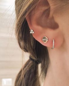 This EF Collection ear party can be purchased at Reservoir LA's brick and mortar store. Pictured are the Diamond Trio Stud, Diamond Huggie and Diamond Screw Stud earrings.