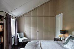 Bedroom with upholstered fabric wardrobe doors