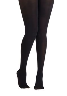 Layer It On Tights in Black. Enjoying your favorite warm-weather clothes year 'round is a cinch now that you've welcomed these black tights into your wardrobe! #black #modcloth