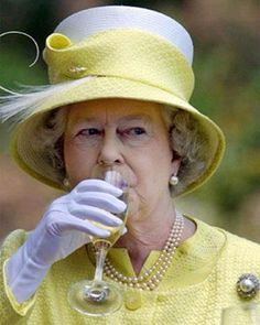 Wow now this must be a rarity to catch Her Majesty taking a sip it must be a damn good vintage.