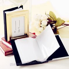 "Every memory you make on your wedding day is worth its weight in gold! Our little gold book of memories photo album wedding favors give your guests the perfect place to preserve precious memories of your wedding--and other happy occasions in their life! Features and facts:Color(s): Gold and black;Materials:Metal, heavy cardboard, black velvet;Details:Beautiful, bead-accented, gold-finish-metal mini photo album with black-velvet back and ""For You"" insert on the front cover holds 24 3 1/2"" x 2…"