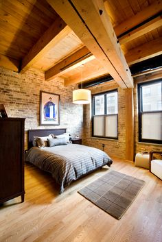 Cozy bed, amazing old building. Exposed wooden beams. Warm light. Yes, please.
