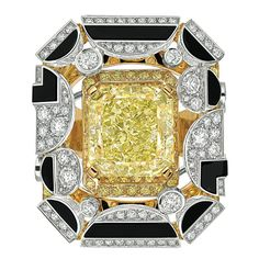 Morning in Vendôme #Ring from #CafeSociety - #Chanel - #FineJewelry collection in 18K white and yellow gold set with a 8.1 carat #EmeraldCut - #YellowDiamond, 164 #BrilliantCut #Diamonds (3.7 cts), 162 brilliant cut yellow diamonds and carved Www.ambragold.com