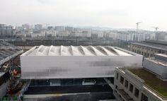 Love the façade treatment - Pajol Sports Centre  / Brisac Gonzalez
