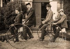 Four Men Seated On A Four Wheeled Cycle