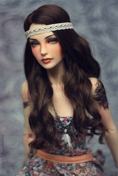 Love everything about this doll's look.  I thought she was a real human being when I scrolled over her first.