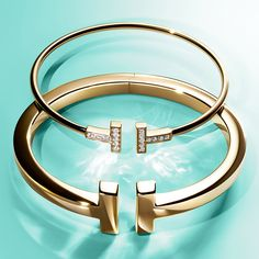 Tiffany & Co. - This year, give the gift of Tiffany. Timeless Tiffany T wire bracelets in gold and a Tiffany In - Tiffany Jewelry, Tiffany Bracelets, Opal Jewelry, Luxury Jewelry, Modern Jewelry, Silver Jewelry, Fine Jewelry, Wire Bracelets, Cartier Jewelry