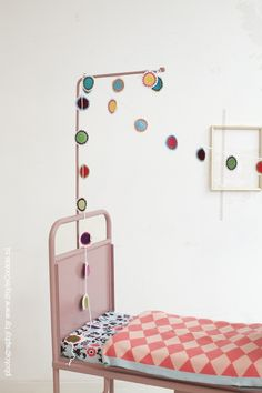 Awesome kids room - vintage bed and garland.